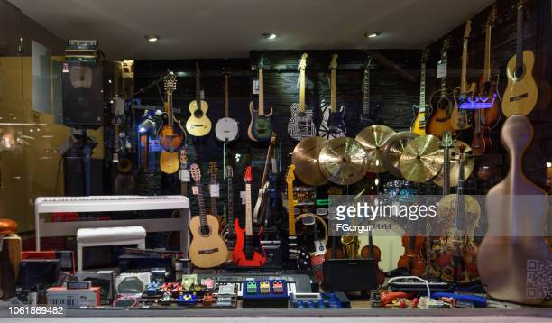 music shop - musical instrument stock pictures, royalty-free photos & images