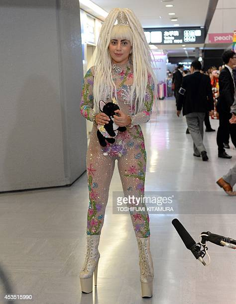 US music star Lady Gaga speaks to journalists upon her arrival at the Narita International airport in Narita Chiba prefecture on August 12 2014 Gaga...