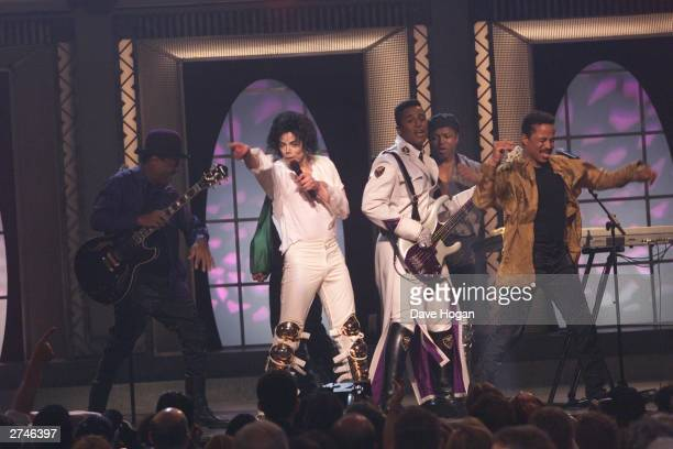 Music star Michael Jackson sings with his brothers the Jackson 5 at the 30th anniversary celebrations held on September 10 2001 at Madison Square...