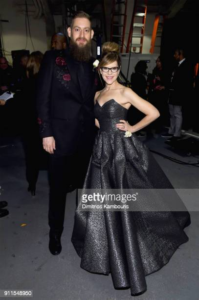 Music supervisor Roey Hershkovitz and recording artist Lisa Loeb pose backstage during the 60th Annual GRAMMY Awards Madison Square Garden on January...