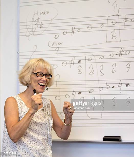 Music teacher at a whiteboard in front of a class