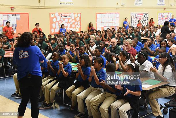 Music teacher Elizabeth Berliant talks with students as StubHub and Mr Holland's Opus Surprise Bay Area Students with new instruments at KIPP Bridge...