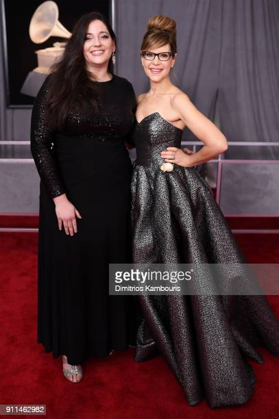 Music teacher Melissa Salguero and recording artist Lisa Loeb attend the 60th Annual GRAMMY Awards at Madison Square Garden on January 28 2018 in New...