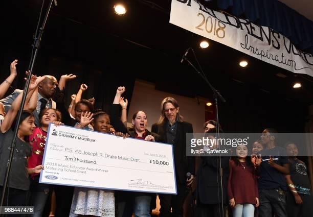 Music teacher Melissa Salguero receives a check during 2018 Music Educator Award Winner Check Presentation on June 6 2018 in Bronx New York