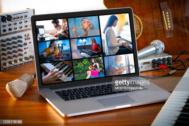 music teleconference with laptop on wood table with microphone and music stuff - entertainment occupation stock pictures, royalty-free photos & images