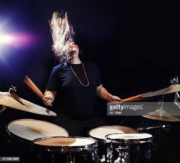 music to bang her head to! - drum kit stock photos and pictures