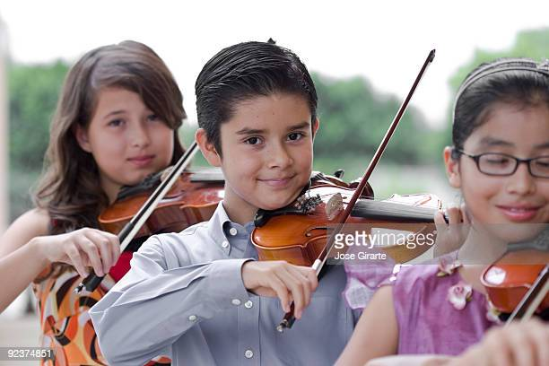 music trio - violin family stock photos and pictures