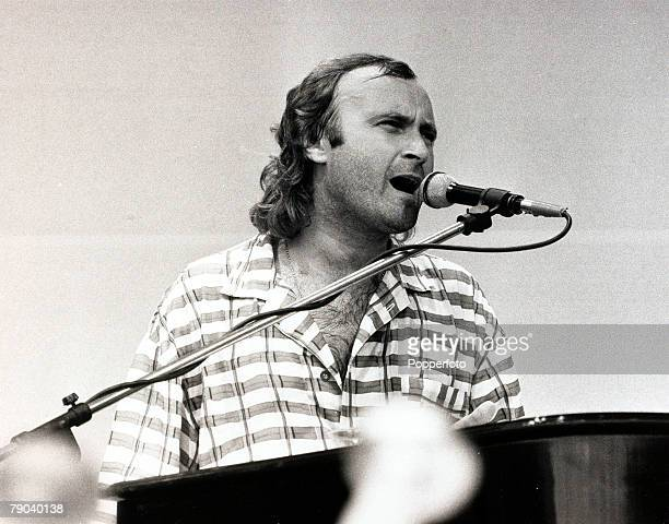 Music Wembley Stadium London England 13th July 1985 British pop star and musician Phil Collins is pictured singing at the Live Aid charity concert...