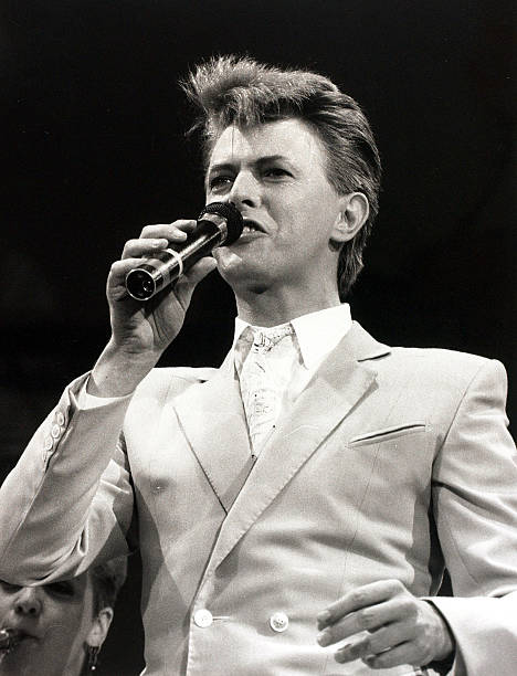 Music. Wembley Stadium, London, England. 13th July 1985. British singer David Bowie is pictured performing at the Live Aid charity concert organised to help Africa's starving millions.