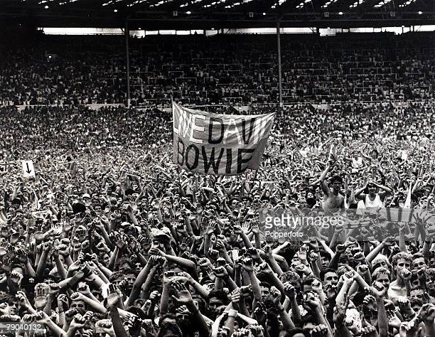 Music Wembley Stadium London England 13th July 1985 Part of the huge crowd at the Live Aid charity concert organised to help Africa's starving...