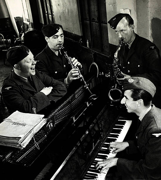 Music. World War II. pic: 29th September 1940. Ronnie Aldrich at the piano, a member of the R.A.F.Dance Orchestra, with Billie Nichols, Andy McDevitt, and Jimmy Durrant.