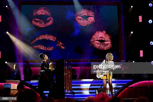 Musical artist Alicia Keys and singer Cam perform onstage during the 10th Annual ACM Honors at the Ryman Auditorium on August 30 2016 in Nashville...