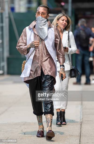 Musical artist Chris Lavish and Olga Ferrara are seen arriving to Studio 189 Presents Fashion Our Future 2020 during New York Fashion week at Spring...