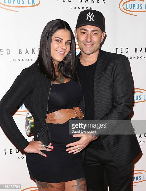 Musical artist Dennis DeSantis and wife attend the 13th Annual Lupus LA Hollywood Bag Ladies Luncheon at The Beverly Hilton Hotel on November 20 2015...