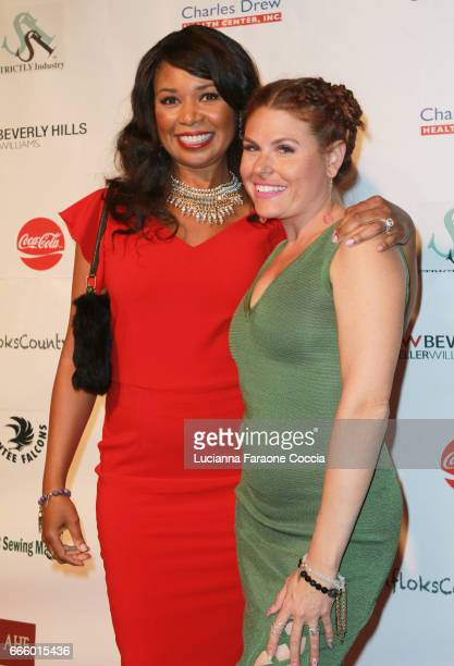 Musical artist Ezina and celebirty stylist Ali Levine attend the Santee High School Fashion Show at Los Angeles Trade Technical College on April 7...