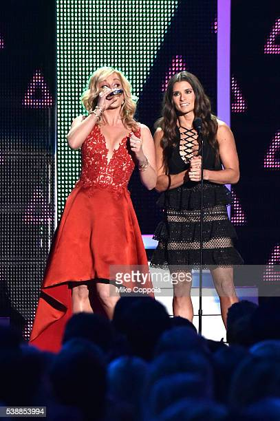 Musical artist Kellie Pickler and rac car driver Danica Patrick present an award onstage during the 2016 CMT Music awards at the Bridgestone Arena on...