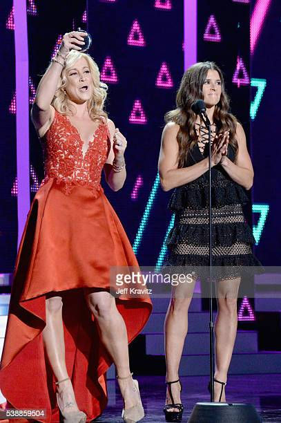 Musical artist Kellie Pickler and race car driver Danica Patrick onstage during the 2016 CMT Music awards at the Bridgestone Arena on June 8 2016 in...