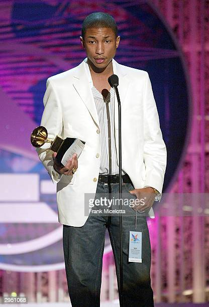 Musical Artist Pharrell Williams accepts The Neptunes Award for Producer of the Year NonClassical at the 46th Annual Grammy Awards held at the...