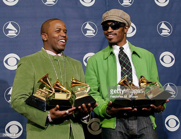 Musical Artists Big Boi and Andre 3000 of Oukast pose with their six Grammys backstage in the Pressroom at the 46th Annual Grammy Awards held on...