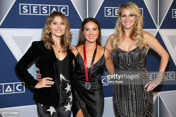 Musical artists Hannah Mulholland Naomi Cooke and Jennifer Wayne arrive at the 2017 SESAC Nashville Music Awards at Country Music Hall of Fame and...