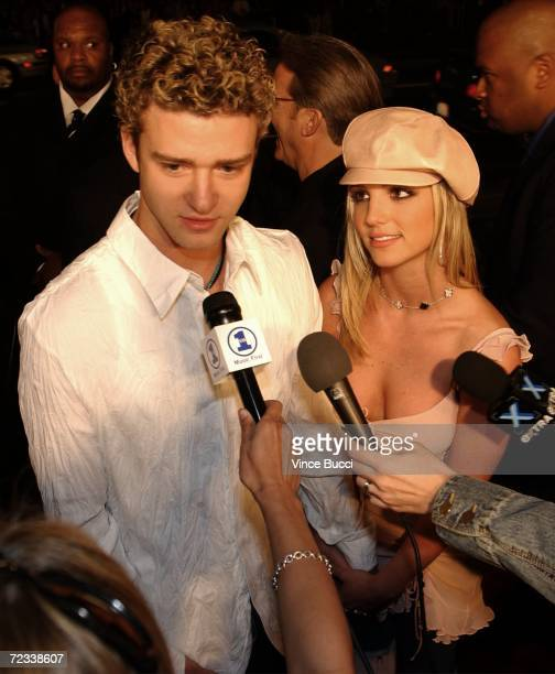 Musical artists Justin Timberlake and girlfriend Britney Spears are interviewed as they attend the premiere of the film 'Crossroads' February 11 2002...