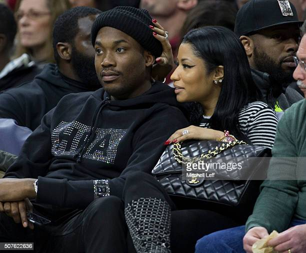 Musical artists Meek Mill and Nicki Minaj watch the game between the Golden State Warriors and Philadelphia 76ers on January 30 2016 at the Wells...