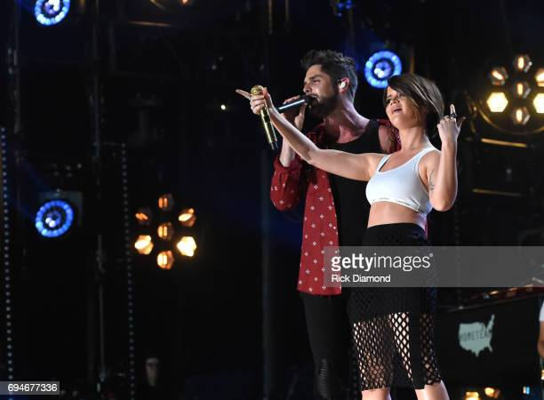 Musical artists Thomas Rhett and Maren Morris perform onstage during day 3 of the 2017 CMA Music Festival on June 10 2017 in Nashville Tennessee
