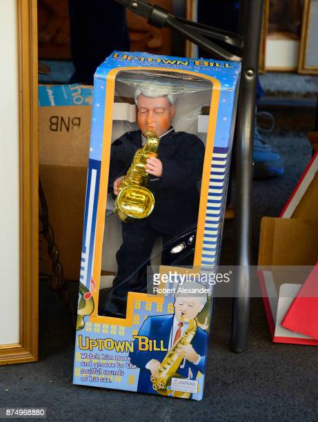 A musical Bill Clinton collectible doll is among the items for sale at a flea market in the Chelsea district of New York City