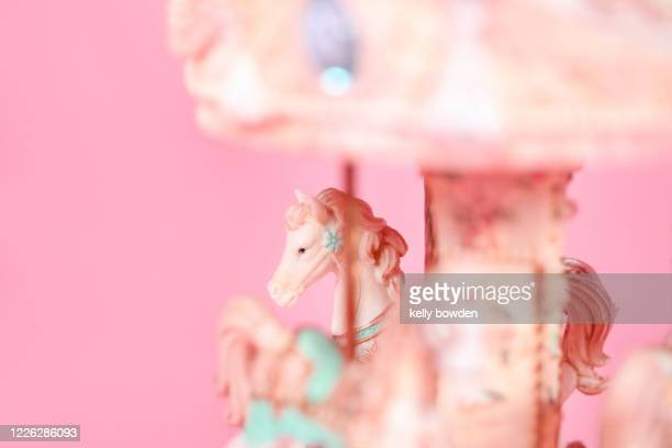 musical carousel horse toy merry go round - kelly bowden stock pictures, royalty-free photos & images
