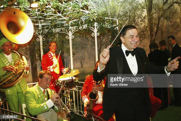 Musical composer Richard Sherman conducts the band at the afterparty for Disney's Mary Poppins 40th Anniversary Edition DVD Launch party and...