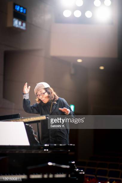 musical conductor in concert hall - musical conductor stock pictures, royalty-free photos & images