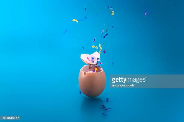 Musical confetti bursting out of an egg