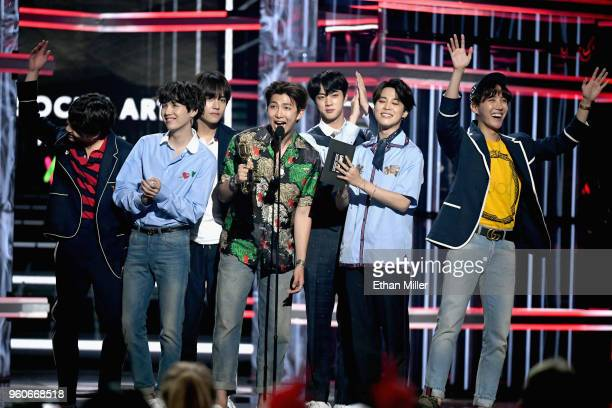 Musical group BTS accepts an award onstage during the 2018 Billboard Music Awards at MGM Grand Garden Arena on May 20 2018 in Las Vegas Nevada