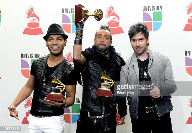 Musical group Camila poses in the press room with their awards during the 11th annual Latin GRAMMY Awards at the Mandalay Bay Resort Casino on...