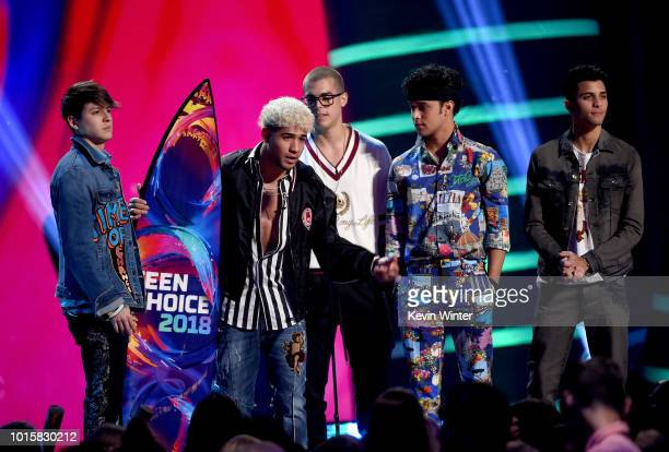 Musical group CNCO accept the Choice Latin Artist award onstage during FOX's Teen Choice Awards at The Forum on August 12 2018 in Inglewood California