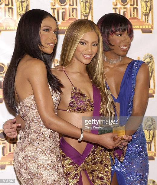 Musical group Destiny's Child poses for photographers at the 15th Annual Soul Train Awards February 28 2001 at the Shrine Auditorium in Los Angeles CA