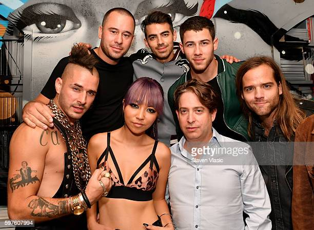 Musical Group DNCE CEO and Founder of Philymack Phil McIntyre Charlie Walk and Island Records Artist Nick Jonas attend a celebration with Republic...