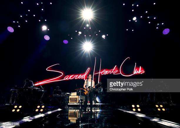 Musical group Foster the People performs onstage during KROQ Almost Acoustic Christmas 2017 at The Forum on December 10 2017 in Inglewood California