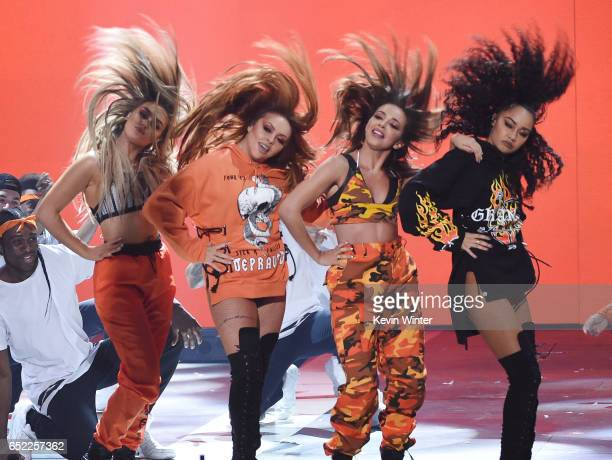Musical group Little Mix performs onstage at Nickelodeon's 2017 Kids' Choice Awards at USC Galen Center on March 11 2017 in Los Angeles California
