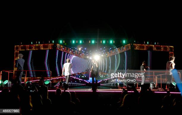 Musical group One Direction performs onstage during the One Direction' Where We Are' Tour at Rose Bowl on September 11 2014 in Pasadena California