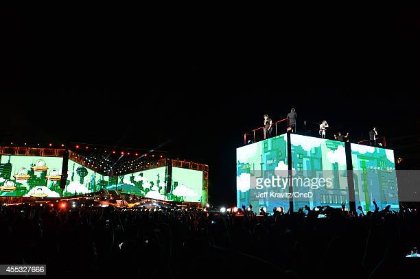 Musical group One Direction performs onstage during the One Direction Where We Are Tour at Rose Bowl on September 11 2014 in Pasadena California