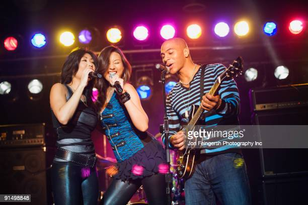 Musical group performing onstage