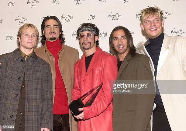 Musical group The Backstreet Boys winners of the award for 'Pop/Rock Favorite Band Duo or Group' pose for photographers at the 28th Annual American...