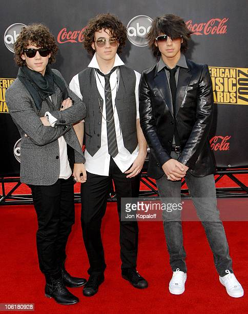 Musical group The Jonas Brothers arrive at the 2007 American Music Awards at the Nokia Theatre on November 18 2007 in Los Angeles California