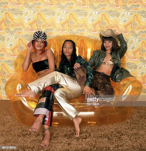 Musical group TLC Tionne TBoz Watkins Rozonda Chilli Thomas and Lisa Left Eye Lopes pose for a studio portrait in 1999 in Hollywood California