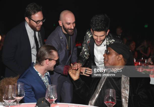 Musical group X Ambassadors and Stevie Wonder attend The Art of Elysium presents John Legend's HEAVEN at Barker Hangar on January 6 2018 in Santa...