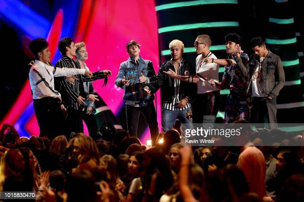 Musical groups In Real Life and CNCO perform onstage during FOX's Teen Choice Awards at The Forum on August 12 2018 in Inglewood California