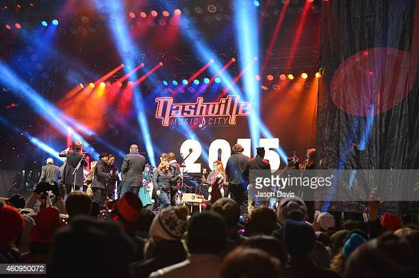 Musical guests that performed throughout the night help sing Auld Lang Syne after welcoming in the New Year during Dick Clark's New Year's Rockin'...