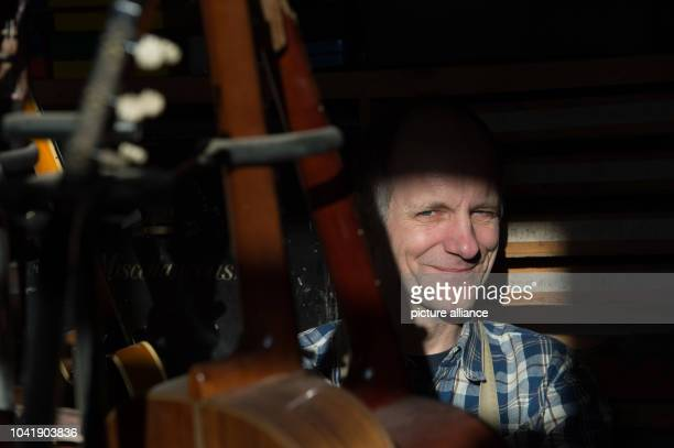 Musical instruments builder Joerg Dahms standing between two instruments in his workshop for historical instruments in Wittenberg Germany 19 January...