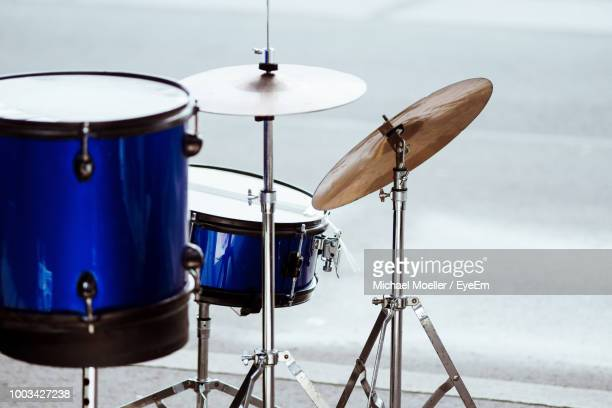 musical instruments on road - drum kit stock photos and pictures
